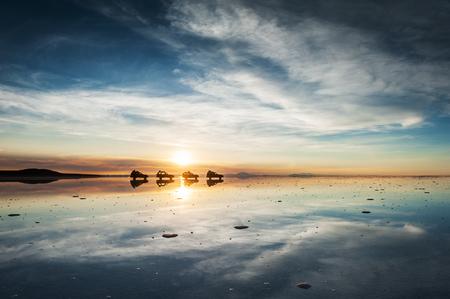 Mirror surface on the salt flat Salar de Uyuni at sunrise, Altiplano, Bolivia
