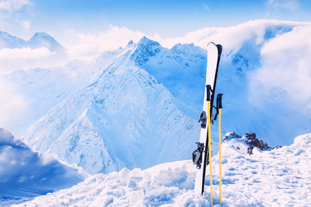 piste: Winter mountains and ski equipment in the snow. Skiing, winter sport Stock Photo