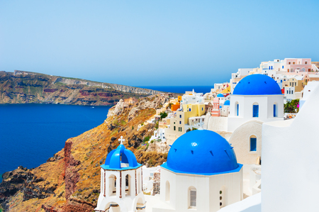 Church with blue domes on Santorini island, Greece. Beautiful landscape, sea view