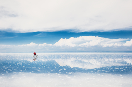 Mirror surface on the salt flat Salar de Uyuni, Altiplano, Bolivia Stock Photo