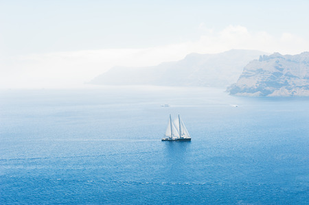Yacht in the sea. Santorini island, Greece. Travel and vacation