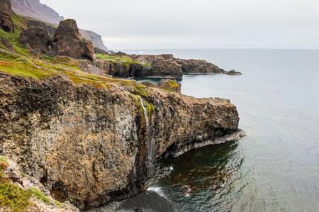 Wild rocky coast on the Disco island, western Greenland