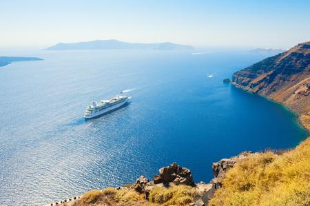 Cruise ship at the sea near the Greek Islands. Santorini island, Greece.
