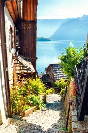 Beautiful street in Hallstatt village, view of Hallstatter lake, Austrian Alps