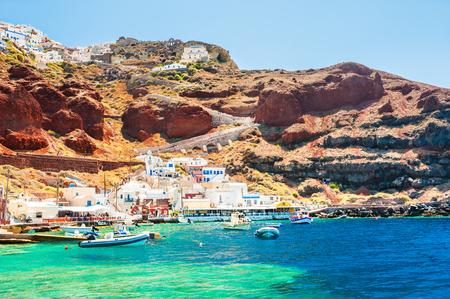 Old port in Oia village on Santorini island, Greece. Summer landscape, sea view