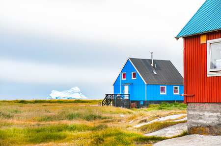Colorful houses on the coast of Atlantic ocean in Qeqertarsuaq village, western Greenland