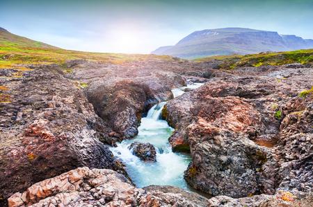 Beautiful waterfall on the Disco island, western Greenland