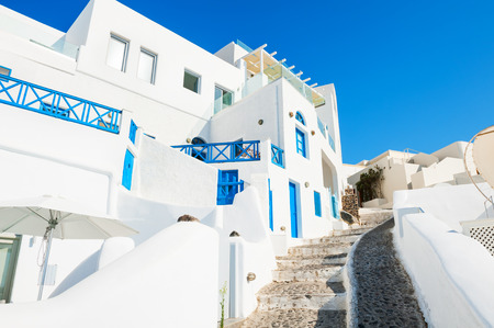 Traditional greek white architecture with blue doors and windows. Santorini island, Greece.