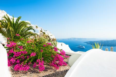 Beautiful terrace with pink flowers on Santorini island, Greece 写真素材