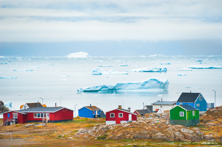 Colorful houses on the shore of Atlantic ocean in Saqqaq village, western Greenland