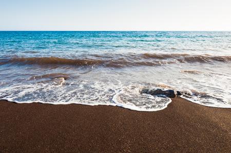 Red beach on Santorini island, Greece. Summer landscape, sea view