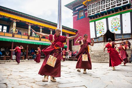 Tengboche, Nepal - October, 24, 2018: The monks perform religious buddhistic dance during the Mani Rimdu festival in Tengboche Monastery