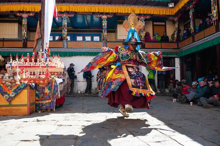 Tengboche, Nepal - October, 26, 2018: The monks perform religious masked buddhistic dance during the Mani Rimdu festival in Tengboche Monastery