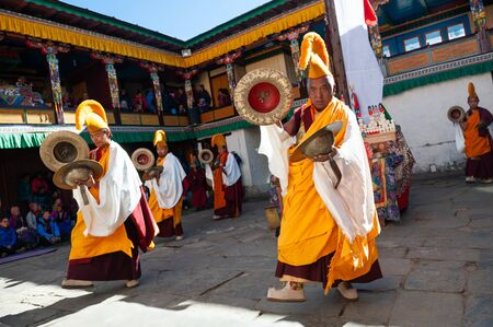 Tengboche, Nepal - October, 26, 2018: The monks perform religious buddhistic dance during the Mani Rimdu festival in Tengboche Monastery