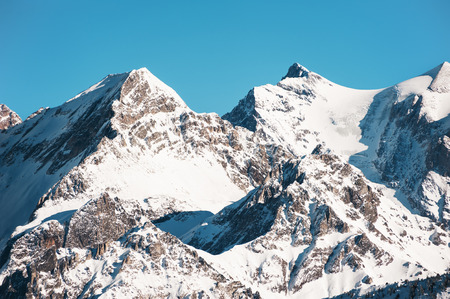 Snow-covered peaks of Alps mountains in Courchevel, France. Beautiful winter landscape