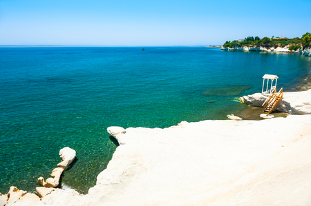 Beautiful beach with turquoise sea and white stones