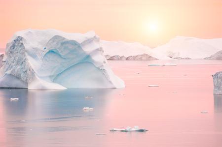 Icebergs in Atlantic ocean at sunset, western Greenland