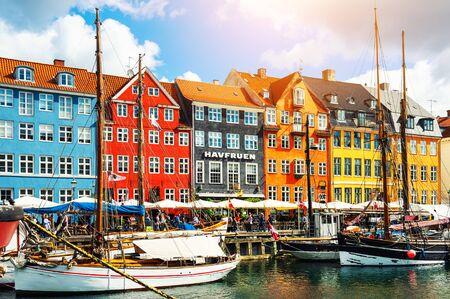 Copenhagen, Denmark - August, 13, 2017: Famous Nyhavn pier with colorful buildings and boats in Copenhagen, Denmark
