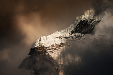 Snow formation on the mountain, Himalayas. Ama Dablam peak with clouds at sunset, Khumbu valley, Everest region, Nepal