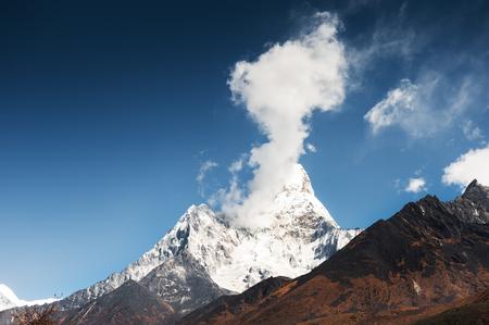 Ama Dablam peak with clouds in Himalaya mountains. Khumbu valley, Everest region, Nepal