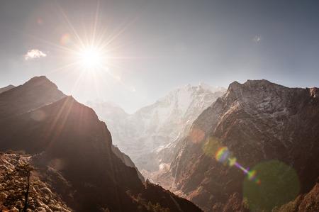 View of Mount Thamserku from Tengboche at sunrise. Himalaya mountains, Khumbu valley, Everest region, Nepal. Lens flare effect