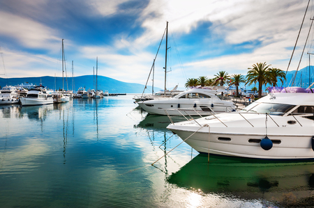 Luxury yachts in the sea port of Tivat, Montenegro. Kotor bay, Adriatic sea. Famous travel destination. Stock fotó