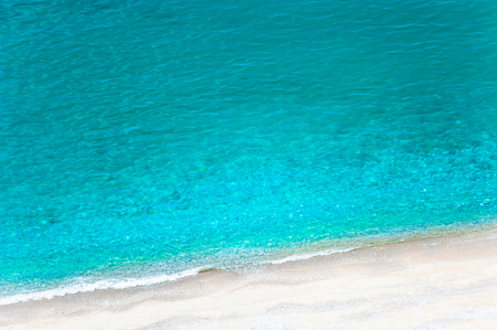 Beautiful sea beach with white sand and turquoise water. Adriatic sea, Montenegro. Summer travel background, top view