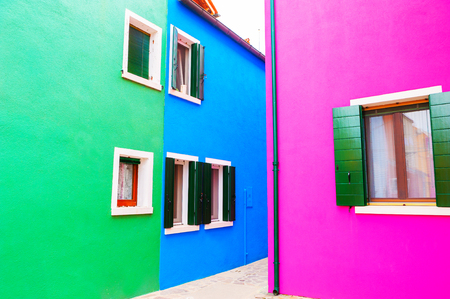 Pink, green and bue colorful houses on Burano island, Venice, Italy