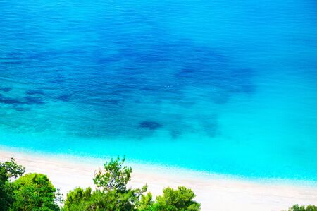 Beautiful sea beach with white sand and turquoise water. Adriatic sea, Montenegro. Summer travel background,
