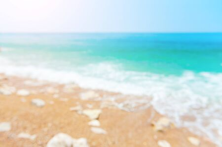 Blurred sea background. Beautiful beach with turquoise water. Travel and vacation concept