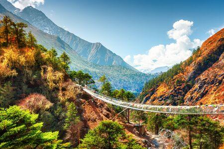 Suspension bridge in Himalaya mountains, Nepal. Khumbu valley, Everest region, Sagarmatha national park Stock Photo