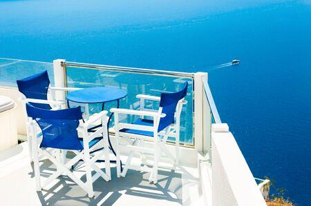 Beautiful terrace with sea view. Santorini island, Greece. Famous travel destination