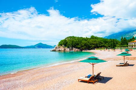 Beautiful beach with chaise lounges in near Budva, Montenegro. Luxury resort at Adriatic sea.