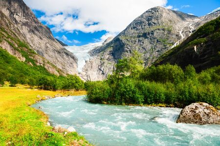 Briksdal glacier and mountain river in Jostedalsbreen national reserve, Norway. Summer landscape. Famous travel destination