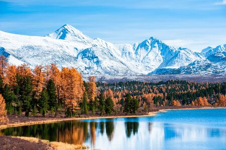 Mountains with autumn forest on Kidelu lake in Altai mountains, Siberia, Russia. Beautiful autumn landscape.