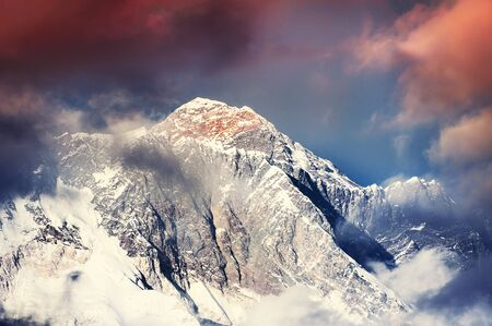 View of Mount Everest and Mount Lhotse at sunset in Himalayas, Nepal. Imagens