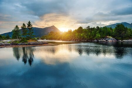 Beautiful sunset on the fjord in Norway. Summer landscape