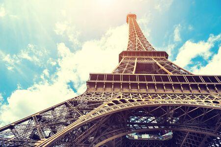 Eiffel Tower against the blue sky in Paris, France. Vintage filter, retro effect