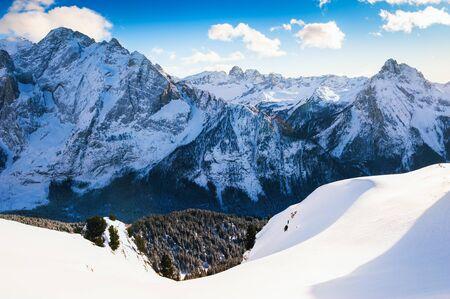 Snow-covered mountains in winter sunny day. Dolomite Alps. Val Di Fassa, Italy. Beautiful winter landscape Archivio Fotografico