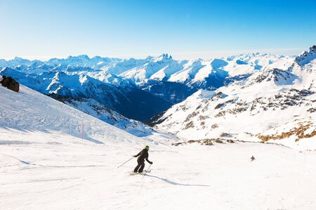 Skier rides down the slope in Alps mountains. Winter sport. Val Thorens, 3 Valleys, France. Beautiful mountains, winter landscape Banque d'images