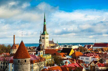Panoramic cityscape of Tallinn, Estonia. Old Town with St. Olaf church and historical Tallinn City Wall