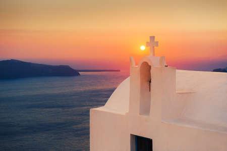 Beautiful sunset at Santorini island, Greece. White church with sea view. Famous travel destination Reklamní fotografie