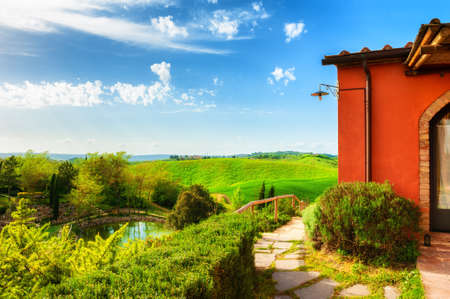 Countryhouse with a view of the green hills in Tuscany, Italy. Beautiful summer landscape Reklamní fotografie