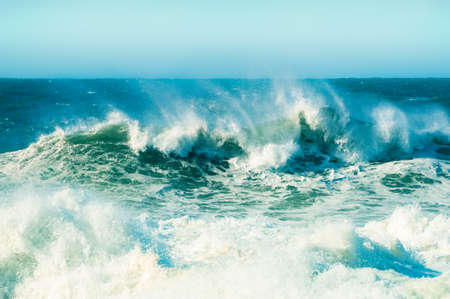 Waves on the coast of Atlantic ocean in Nazare, Portugal. Beautiful nature background.