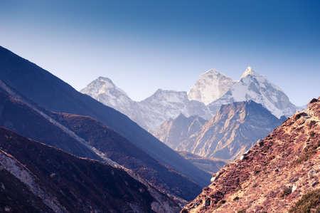 View of Kangtega mount in Himalaya mountains at sunrise. Khumbu valley, Everest region, Nepal.