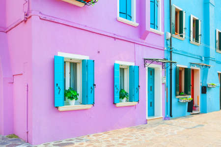 Purple and blue facades of the houses. Colorful architecture in Burano island, Venice, Italy. Famous travel destination