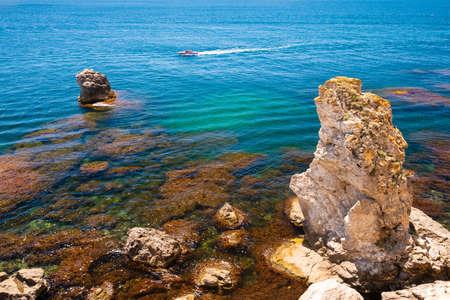 Beautiful sea coast with turquoise water and rocks. Tarhankut Cape on the western coast of Crimea peninsula. Summer seascape, famous travel destination