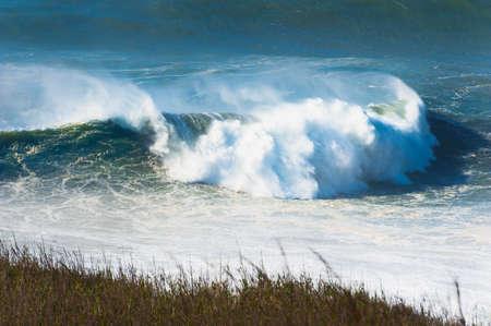 Waves on the coast of Atlantic ocean in Nazare, Portugal. Beautiful autumn seascape