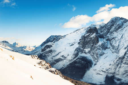 Snow-covered mountains in winter sunny day. Dolomite Alps. Val Di Fassa, Italy. Beautiful winter landscape Reklamní fotografie