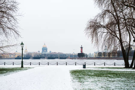 Winter landscape in Saint Petersburg, Russia. View of Neva river and St. Isaac Cathedral from the Peter and Paul Fortress. Winter park with snow